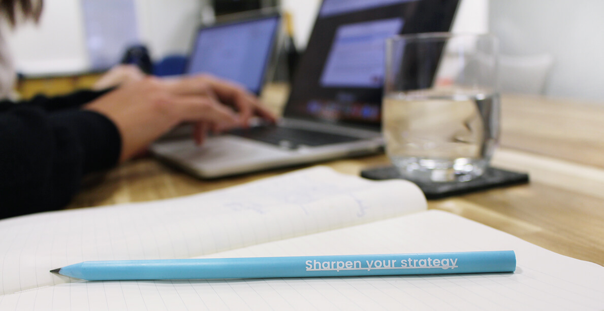 A photo of a pencil with the words 'Sharpen your strategy' written on it.