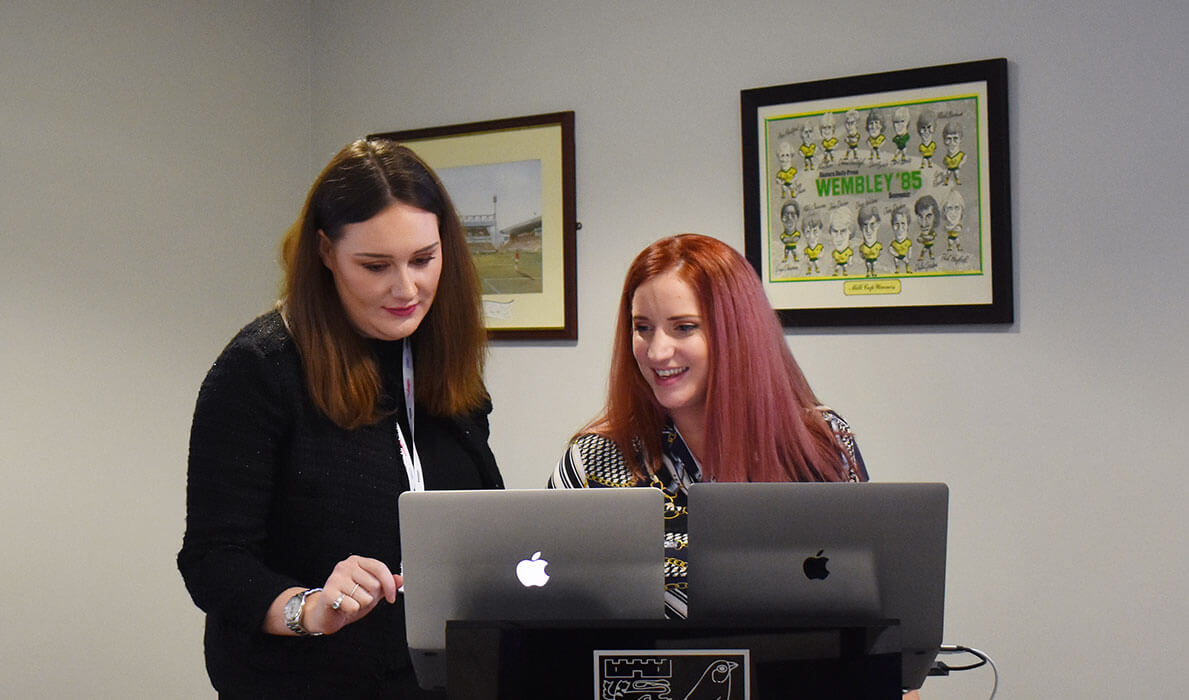 Jordan Wilson and Elodie Partridge preparing their presentations for a Selesti Digital Marketing Masterclass